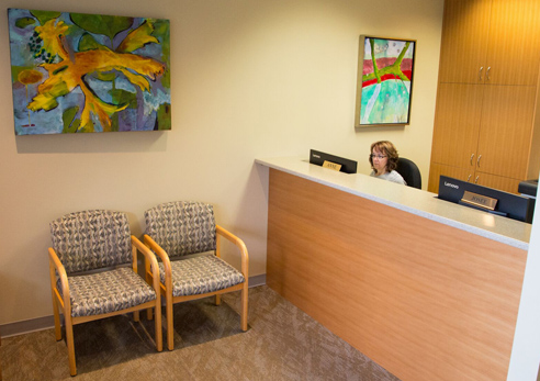 Dogwood Family Dentistry reception area with beautiful flowers on the counter.